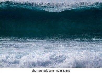 A perfect surfing wave breaking on the north shore of Oahu Hawaii
