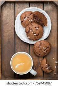 The perfect tasty breakfast!) Chocolate chip cookies with dark chocolate and sea pink Himalayan salt and cup of coffee on a gray concrete background. Best Brown Butter Cookies.