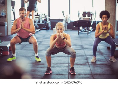 Perfect teamwork. People at gym.