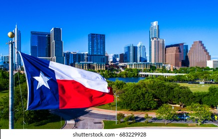 Perfect Texas Flag waving in front of the Perfect Austin Texas USA Skyline representing the Lone Star State with Drone view of our Iconic Capital City