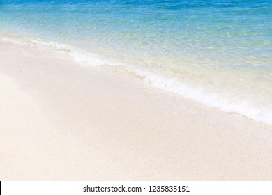 Perfect turquoise sea water with white sand tropical background