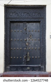 perfect up-right picture of historic typical wooden door in Stone town zanzibar - Tanzania