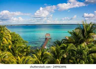 Perfect view of caribbean lagoon Bacalar. Seven Color water. Pier and Hut.