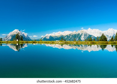 Perfect view on Kaltwassersee in Seefeld in Tirol and mountains reflecting in lake water