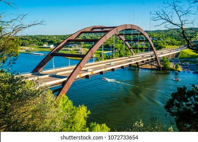 Perfect view of the Pennybacker Bridge or 360 Bridge afternoon sunset in Austin , Texas , USA from within the forest looking out over the Texas Hill Country Landscape View