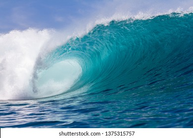 perfect wave breaking in Indonesia on a shallow reef