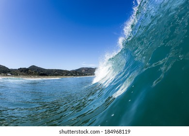 Perfect Wave/ a perfectly glassy wave pitches and tubes at North Piha Beach, New Zealand