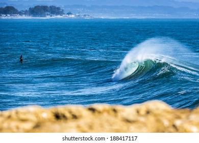 Perfect waves breaking in south Santa Cruz in California.
