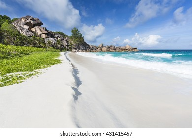 Perfect white beach Grand Anse in La Digue, Seychelles with ist famous granite rock formations