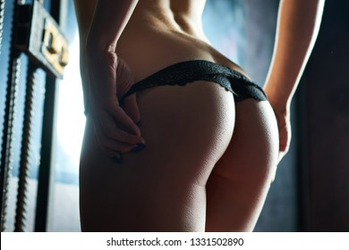 Perfect woman ass in a black panties, girl takes off her panties