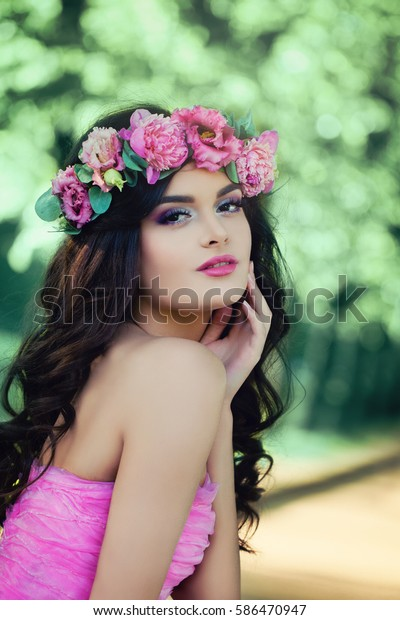 Perfect Woman with Healthy Skin, Makeup and Flowers Outdoors. Summer Beauty, Facial Treatment and Cosmetology