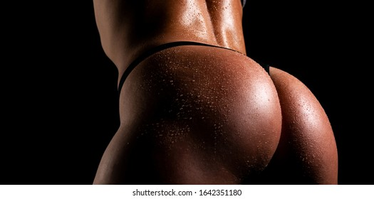 Perfect womans body. Sexy woman butt with raining water. Sexy beautiful girl in black underclothes. Perfect womans body, ass