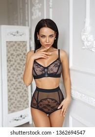 Perfect young beautiful girl in a sexy black lingerie
