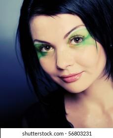 Perfect young face. Creative makeup. Close-up.