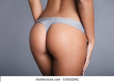 Perfect young girl ass in a gray panties