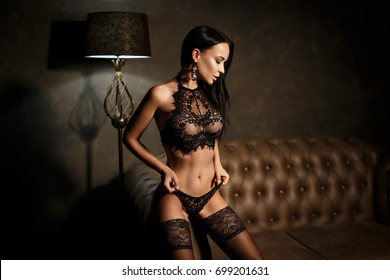 Perfect young girl in sexy black lingerie in glamour style