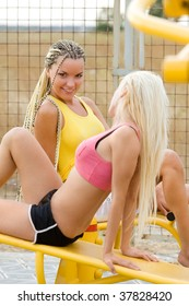 Perfect young models working out on fitness playground