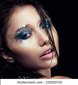 Perfect young woman - bright stylish makeup. Sensuality and beauty. Wet hair