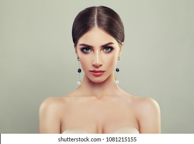 Perfect Young Woman with Jewelry Silver Earrings with White and Blue Pearls on Banner Background