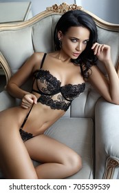 Perfect young woman in a sexy black lingerie