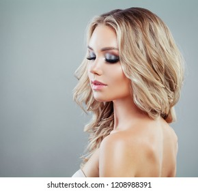 Perfect young woman with wavy blonde hair and makeup on banner background