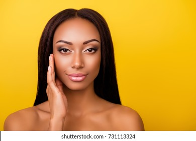 Perfection is a hard work! Pampering, pimple, wrinkle, clear and clean, oily, dry skin concept. Cose up cropped photo of afro gorgeous charming brunette touching gently her ideal face
