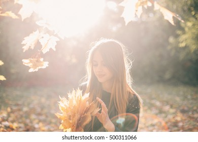 Perfectly beautiful brunette girl in autumn park