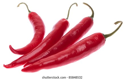 Perfectly fresh red hot peppers isolated on white.