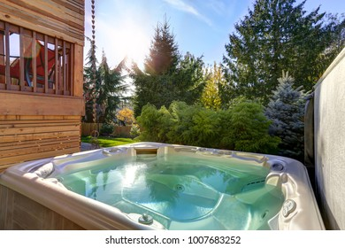 Perfectly manicured backyard boasts modern hot tub for quiet relaxation. Northwest, USA