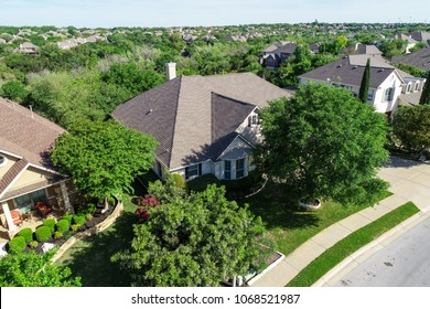 Perfectly manicured lawns and Green Landscape and Luxury Homes in Spring time green aerial drone view of Suburb Houses and suburbia neighborhood in North Austin , Texas suburb Cedar Park