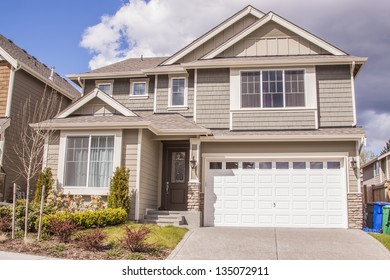 perfectly manicured suburban house on a beautiful sunny day