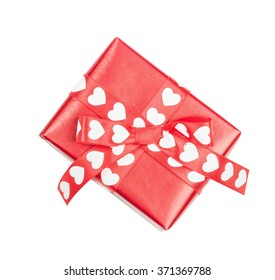 Perfectly packed gift with bow from ribbon hearts for St. Valentine's Day on the white