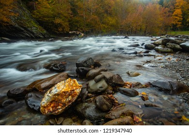 A perfectly placed quartz rock in the Little River in Smoky Mountains National Park in Fall