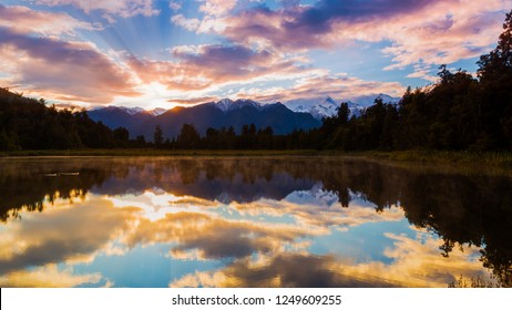 Perfectly reflection of Mount Cook on the Lake Matheson in Fox Glacier, West Coast, New Zealand in the morning sunrise
