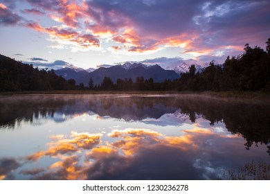 Perfectly reflection of the Southern Alps with twilight on the Lake Metheson in Fox Glacier, West Coast, New Zealand during the dawn