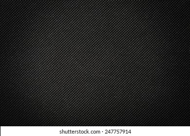 perforated black textile pattern texture background or backdrop