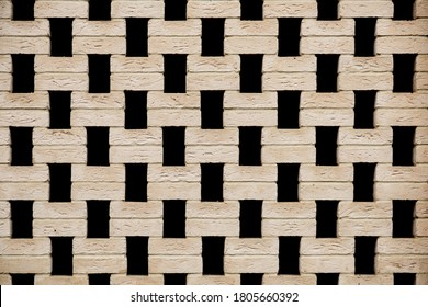 Perforated brickwork. 			texture of a wall made of unusual beige stone