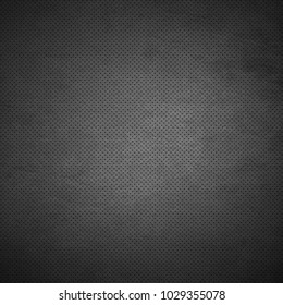 Perforated leather texture with dark vignette for background