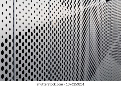 Perforated metal panel. Facing of buildings and structures perforated metal siding. Horizontal.