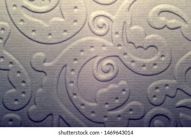 Perforated paper. Flat brown cardboard background texture with perforated lines.