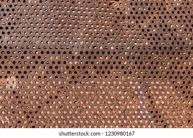 perforated and rusty metal, rusty and leaky metal plate, metal corroded texture, rusty metal background, brown