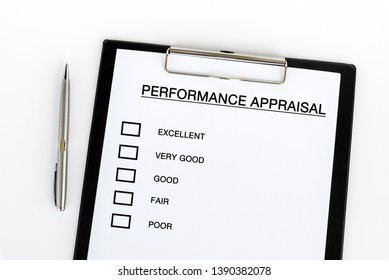 Performance Appraisal checklist on attached on Clip board and pen on white background