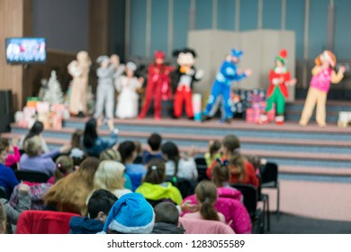 Performance for children on stage. Children on stage perform in front of parents. image of blur kid 's show on stage at school , for background usage. blurry.