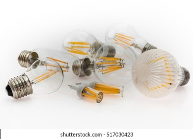 a performance different types of E27 and G4 LED bulbs with different number of LED filaments, focusing on the bulb in the foreground