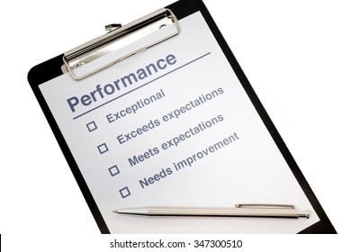 Performance evaluation paper with pen and tick marks on clipboard