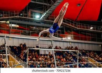 performance in gymnastics female gymnast in uneven bars