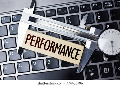 Performance measurement or level with caliper on computer notebook