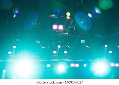 Performance moving lighting on construction light beam ray downward in yellow blue color, on Concert and Fashion Show stage ramp. LED par new technology to save power more color and high density Light