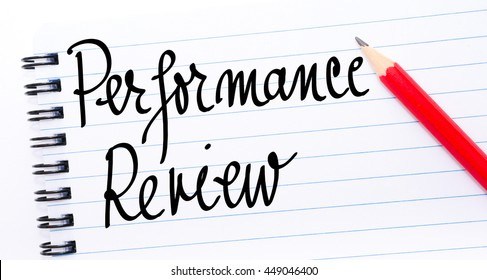 Performance Review written on notebook page with red pencil on the right