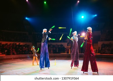 The performance of stilt-walkers in the circus.